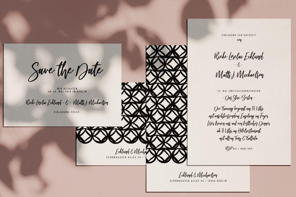 Moderne Hochzeitskarten mit passenden Save the Date Karten und eklektischem Muster auf der Rückseite.