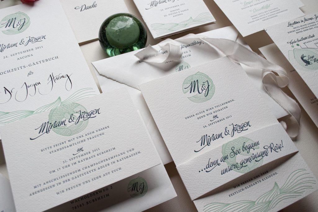 Einladungsset mit Hochzeitslogo Fisch und Monogramm, Hochzeitsthema See für die grosse Feier am Lago Maggiore, Ascona.
